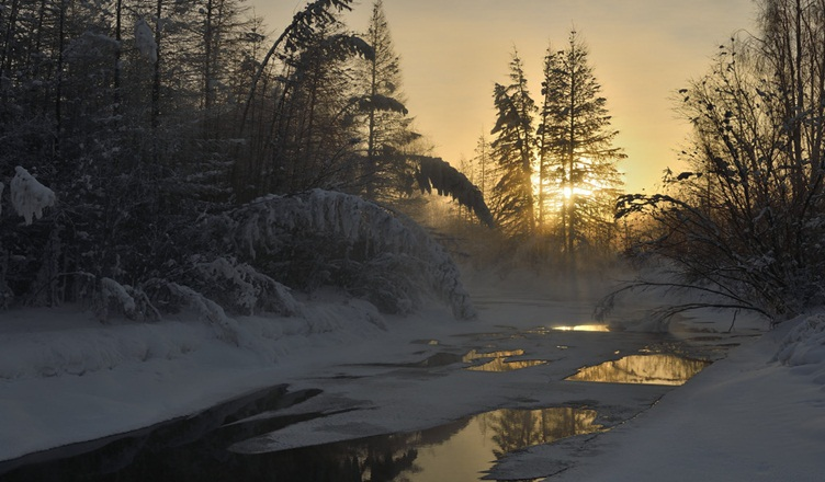 Non-freezing stream at -50C degrees in the morning Oymyakon Russia